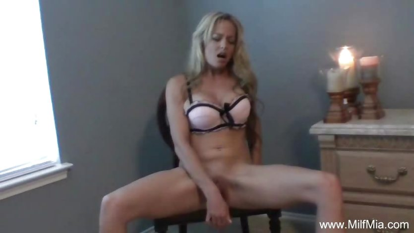 Blonde MILF Plays On a Chair