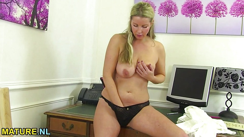 Busty MILF masturbating in the office