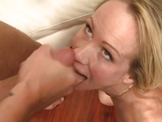 Gorgeous MILF takes a facial