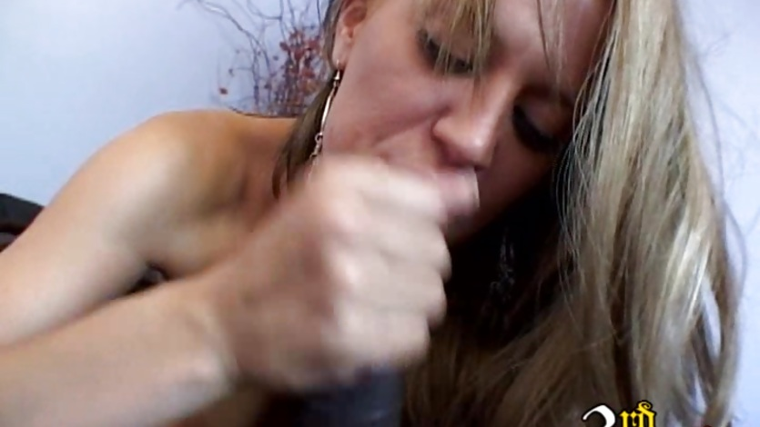 Holly Wellin deep throats a massive black cock