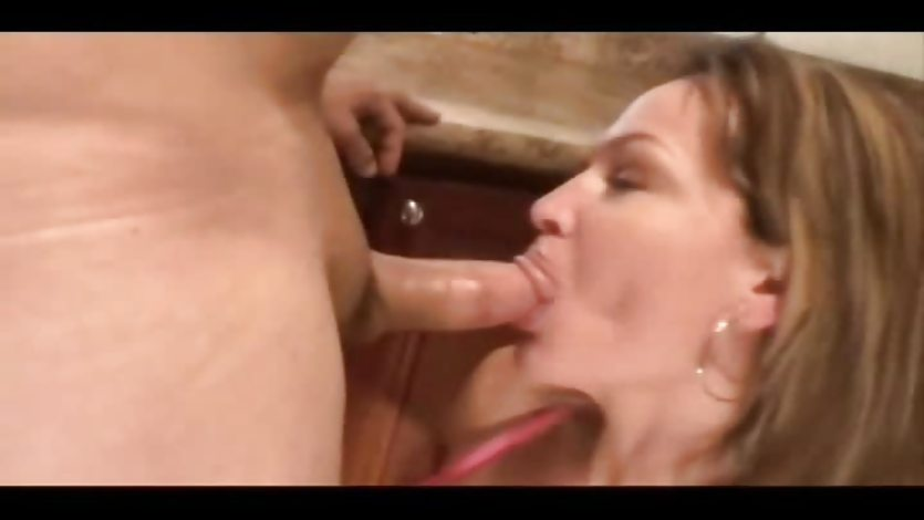MILF Blows One In The Kitchen