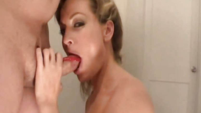 MILF Sucks Cock With a Twizzler