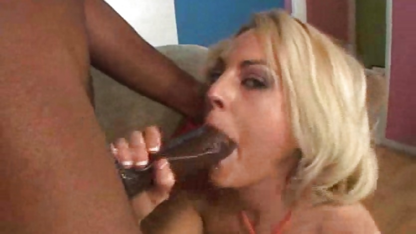 Sindy Lang deep throats a large black cock