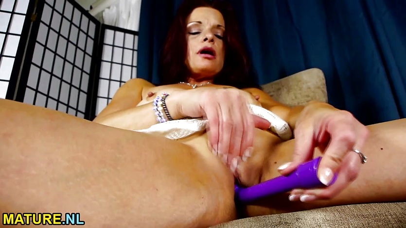 American mature using a purple toy