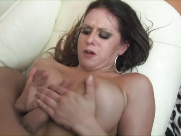 Big titted babe milks cum from a cock with her tits