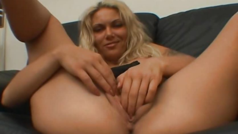Blonde MILF masturbates on the couch