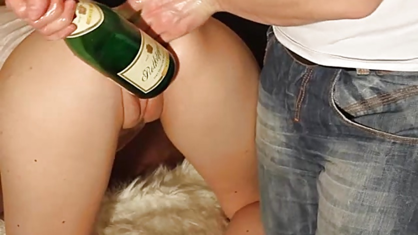 Double fisting and giant bottle fucked amateur girl
