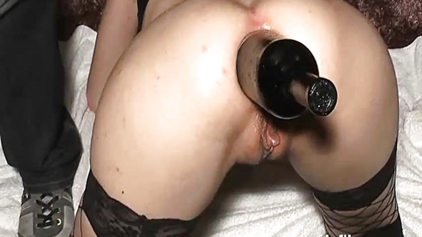 Fisting and fucking her ass with a huge bottle