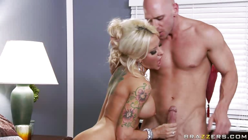 Hot blonde shoves a huge cock deep in her throat
