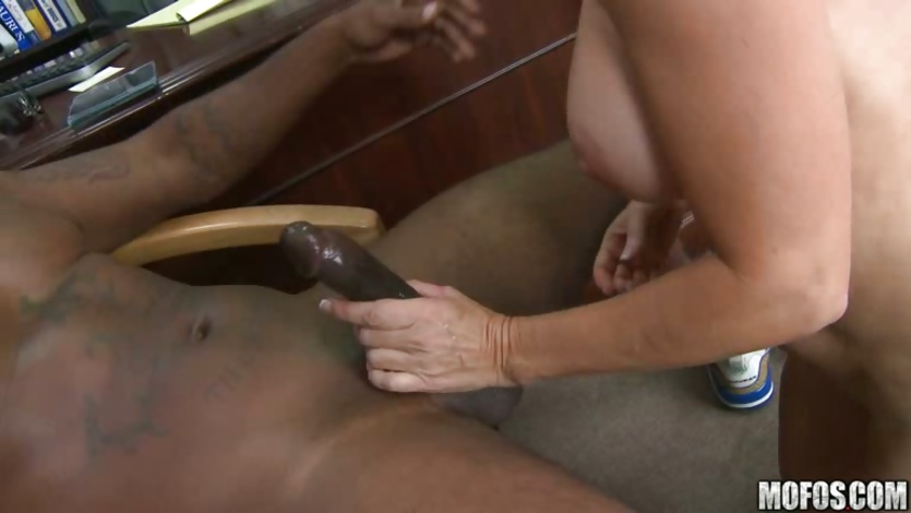 Blonde milf Totally Tabitha takes a black tickler down her deep throat