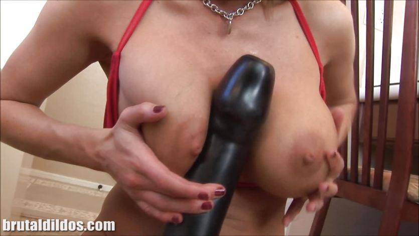 Busty milf squirting from a massive brutal dildo