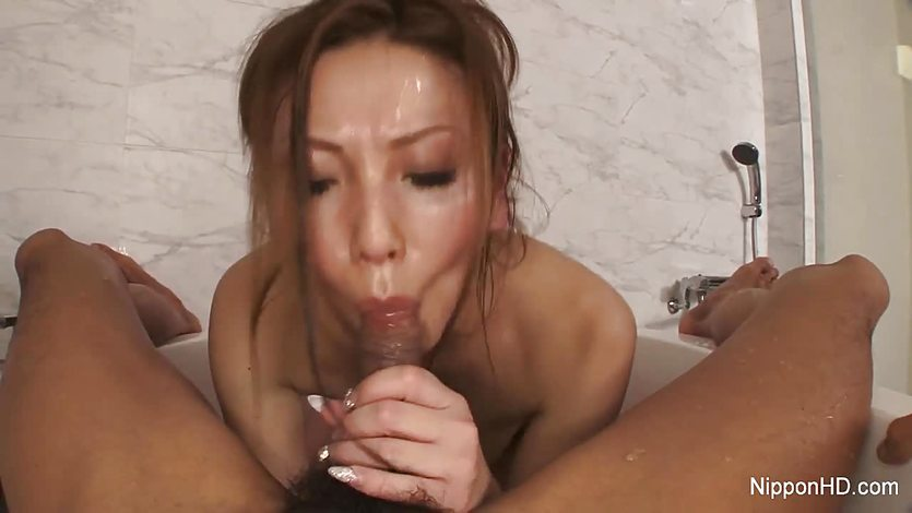 She gives him a blowjob in the bath